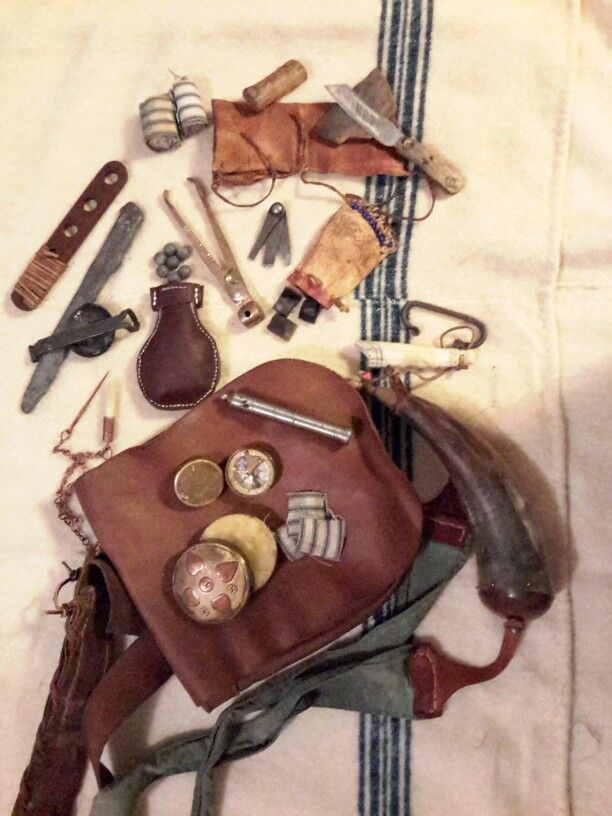 Everything needed for the care and feeding of a flintlock.  Shooting pouch, patch lube, patches, adjustable powder measure, compass, powder horn, powder measure, pan brush, vent pick, spare flints, balls, bar lead, ladle, loading block, ball mold, screwdrivers, patch knife, whetstone, cow's knee (lock cover), wax candle (for waterproofing pan cover), spare patches, spare striker.