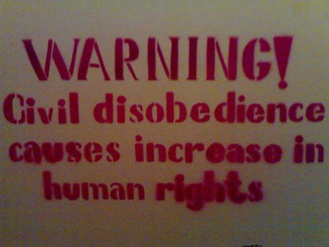 [protest sign stencil: Warning! civil disobedience causes increase in human rights]