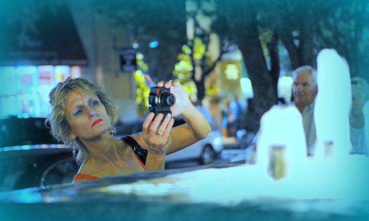 "Candid shot of the photographer/ Pamela, while using small digital camera : ""PRE-NIKON DSLR."""