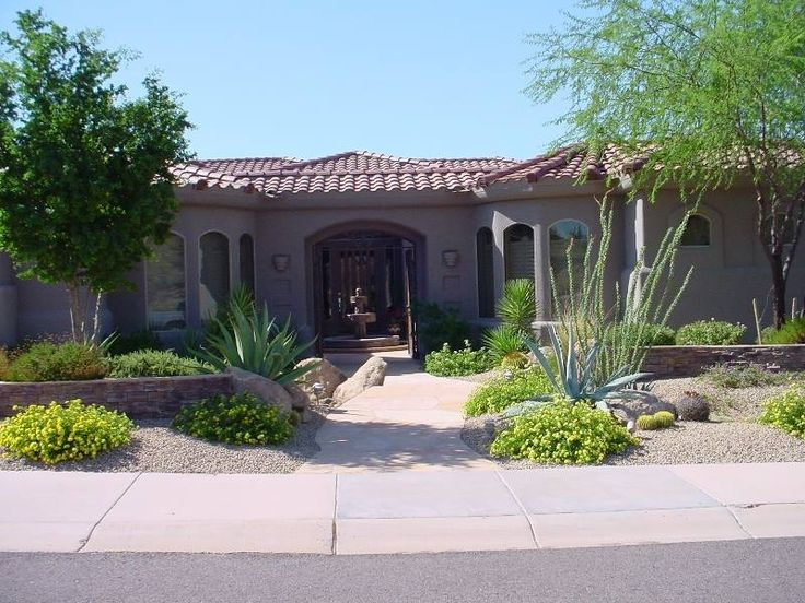 A well balanced front yard design with stone walls and for Courtyard stone and landscape