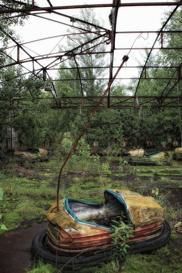 Bumper cars rusting away at an amusement park in abandoned Chernobyl.