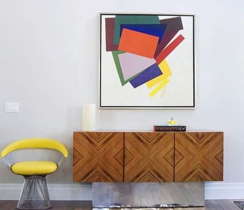 Contemporary modern with a vibrant abstract art piece, canary yellow leather/metal side chair complementing the detailed front of this gorgeous natural wood credenza.....artfully composed.
