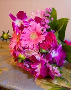 GORGEOUS pops of color in this pink Gerbera and Lisianthus bridesmaid bouquet. Large enough to be a bride's bouquet, too. LOVE this!