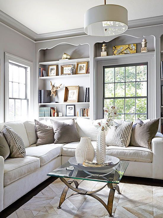 These floor-to-ceiling bookcases draw the eye with shapely headers that craft fine-cabinetry compartments: http://www.bhg.com/decorating/storage/shelves/bookshelves-styles-sizes-photos/?socsrc=bhgpin100814makeastatement&page=10