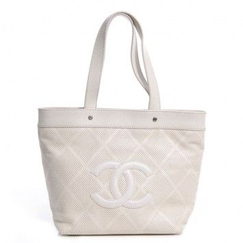 Chanel Leather Perforated Large White Tote Bag. Get one of the hottest styles of the season! The Chanel Leather Perforated Large White Tote Bag is a top 10 member favorite on Tradesy. Save on yours before they're sold out!