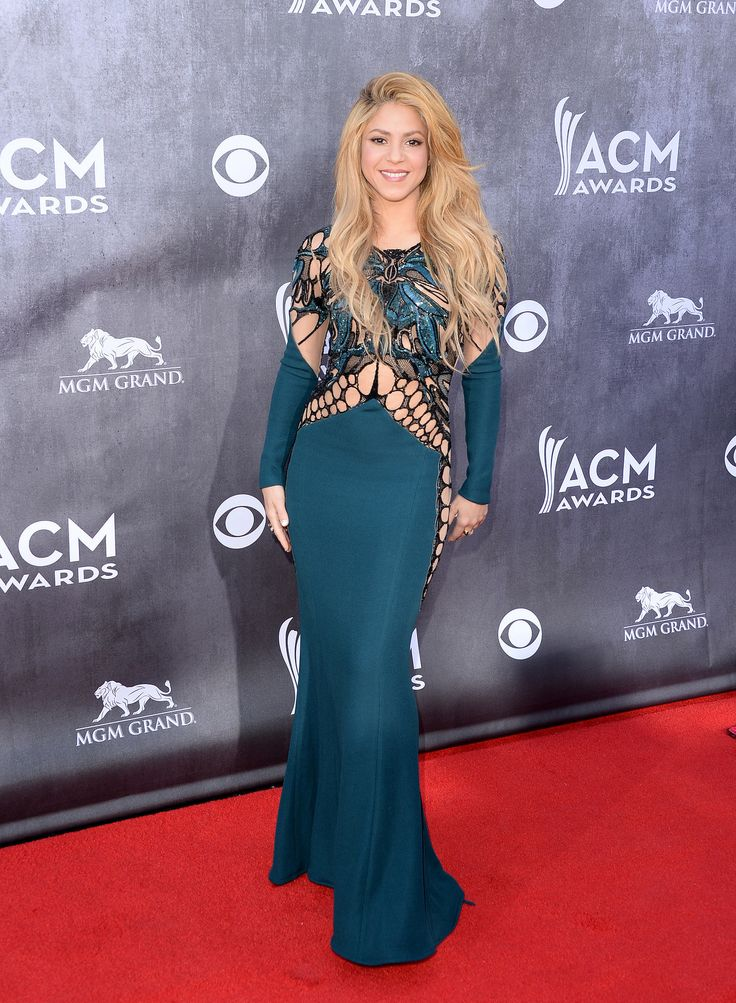 Shakira hit the red carpet in a webbed and cutout Zuhair Murad gown.