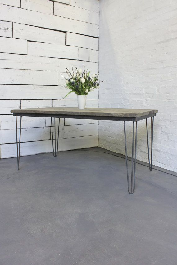 reclaimed grey washed scaffolding board dining table with dark steel hairpin legs its industrial design works perfectly in a sophisticated