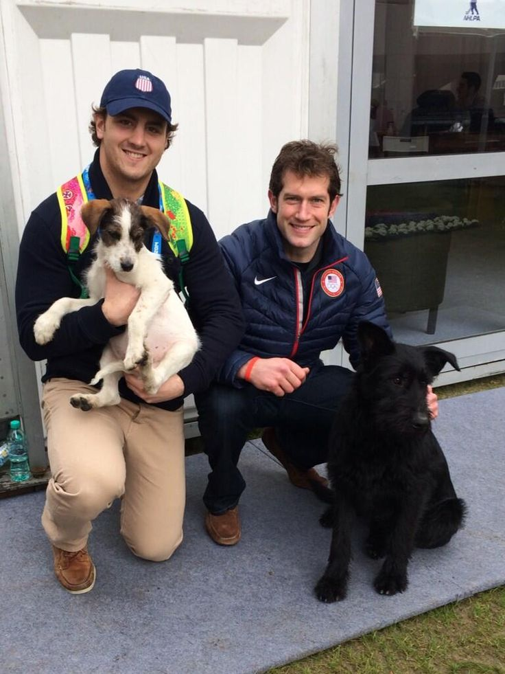 Shatty and Backes pose with the dogs that Backes and his wife rescued in Sochi.