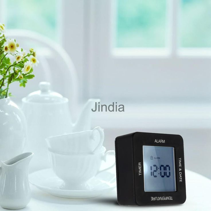 Digital Rotating Timer, Alarm, Time, Calendar And Temperature Alarm Clock