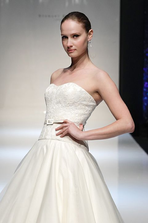 Get Happy - Stewart Parvin Wedding gown. French lace corded bodice with super-full organza and tafetta skirt.  www.stewartparvin.com