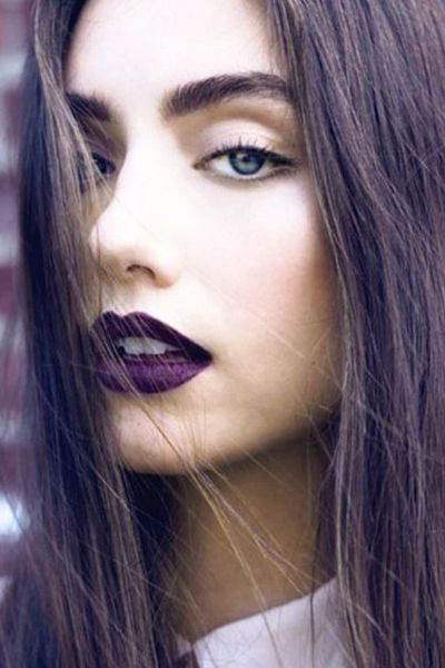 Fall 2014 makeup looks - A deep, true purple lip needs little other emphasis. Just be sure to apply with a lip brush for clean, defined lines.