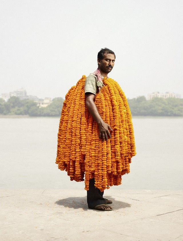 Flower vendors from Calcutta's Malik Ghat flower market, one of the oldest and the largest of its kind in India.