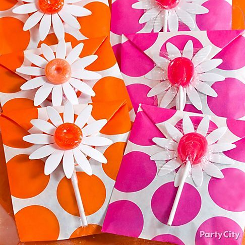 Turn favor bags into little packets that hide candy inside ... We topped the sweet daisy details with Life Saver centers!