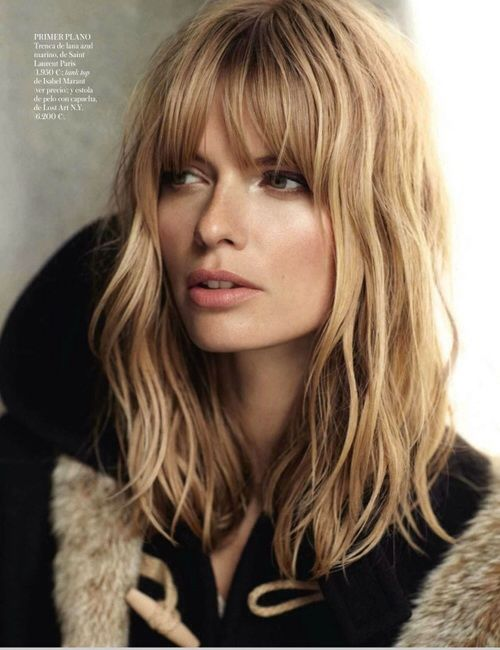 mid length cut with very long layers and bangs. Love the color!
