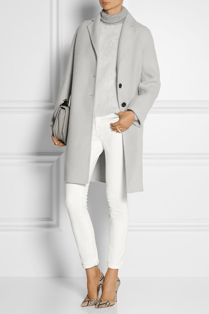 MARC JACOBS Alpaca and wool-blend coat $1,900 EDITORS' NOTES & DETAILS Give your outerwear a modern refresh with Marc Jacobs' alpaca and wool-blend coat. In an on-trend light-gray hue, this mid-weight design has a loose fit, flap pockets and a back vent. Work yours with a two-tone sweater and white jeans.