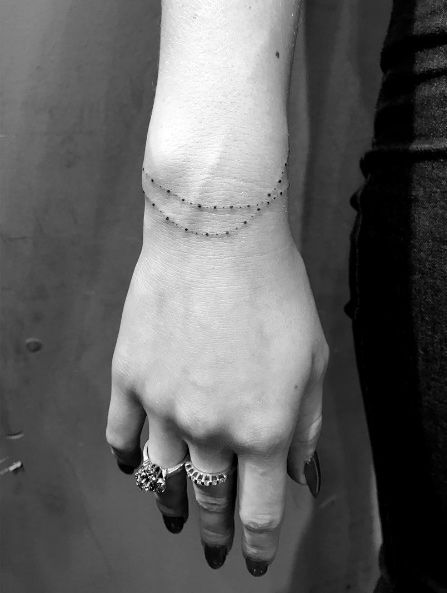 Bracelet tattoo by Daniel Winter