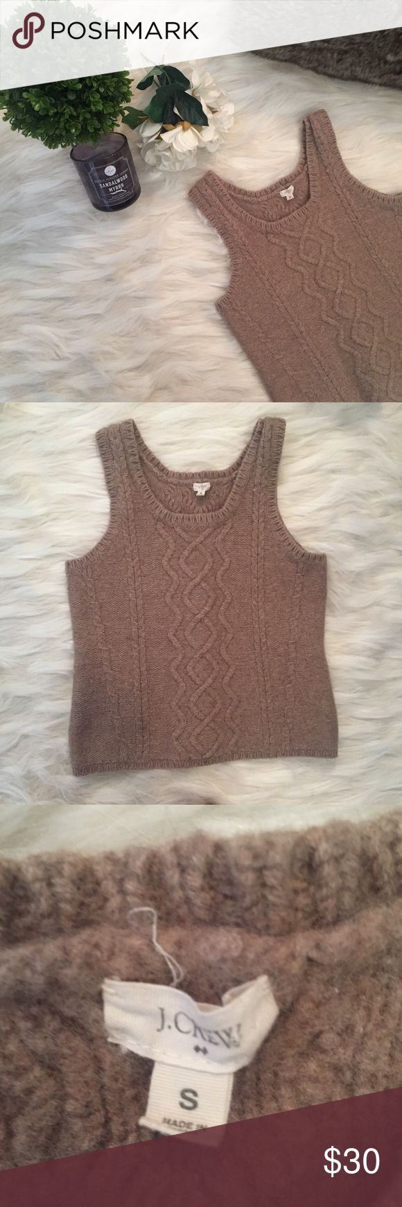 J Crew Sweater Vest J Crew Sleeveless sweater in tan color. Sweater has a braided detail going down the front and similar detail going down the middle of the sweater. The sweater is very thick and warm. The sweater is fitted but had some stretch to it. The sweater has a scoop neckline and fits true to size. J.Crew Factory Sweaters Crew & Scoop Necks