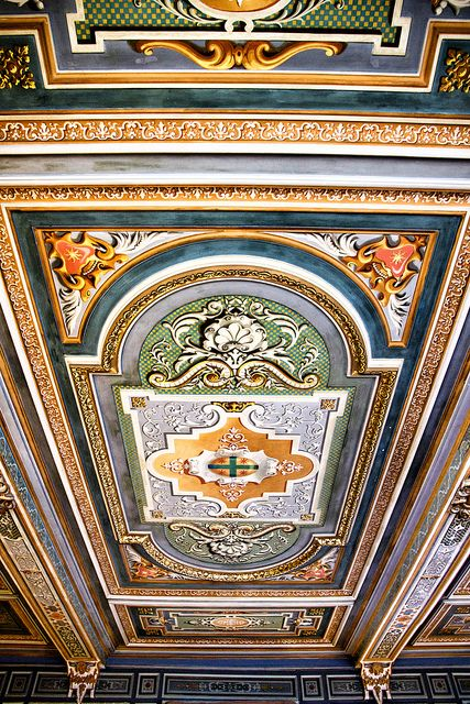Preserved ceiling within the Château de Cheverny, France. This is a gorgeous display of European pattern with rich colour.