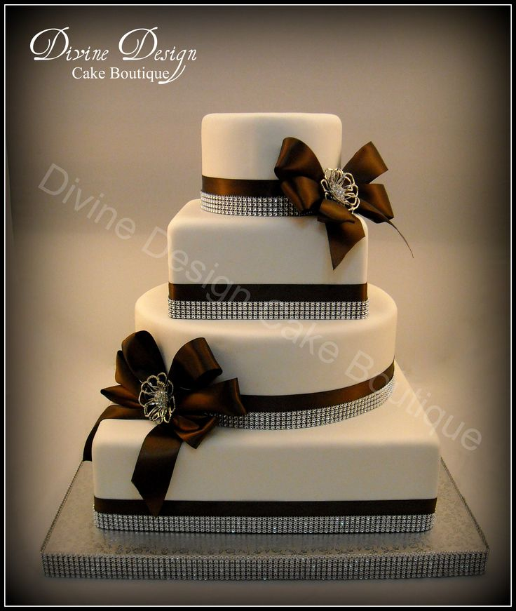 Glitz n Glamour - Cake covered in fondant. Chocolate brown satin ribbon, diamond trim and diamond broach complete this design.