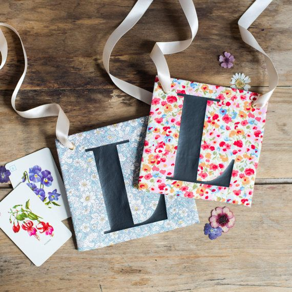 Handmade to order, these beautiful Hen Party L Plates are a great alternative to the pink and fluffy ones you can commonly find!  Choose from these two floral fabrics (or browse the shop for more different options) your L Plate measures approx 14 x 14cm, and is finished with hand pressed metal eyelets and double faced satin to hang around the neck, or as a decoration. To hold the shape, there is an insert of cardboard therefore it is important to avoid getting wet. Please do not iron.  Your…