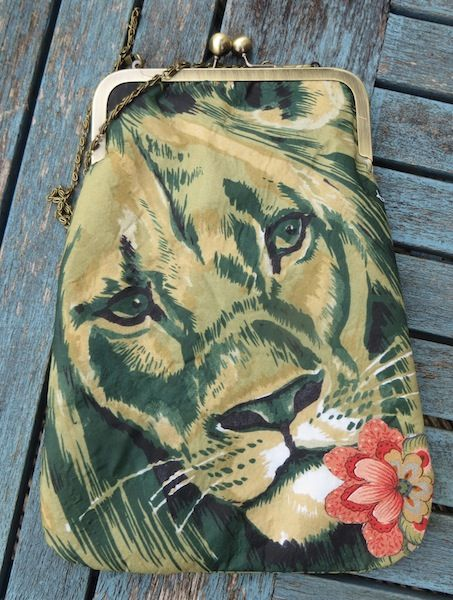 'Lion' The king of the jungle makes a strong feature on this cross-body bag which has been made from a 1950's scarf.  It has a long chain handle and comes in  gift box.