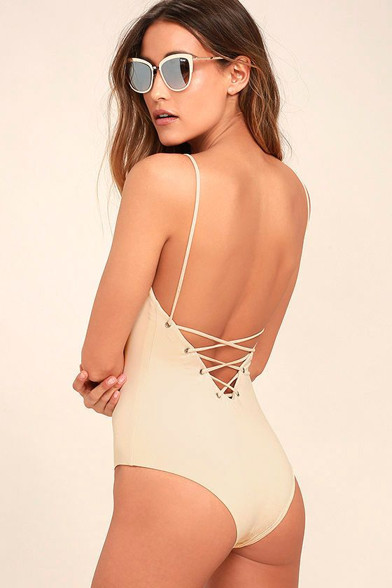 The Tavik Monahan Beige Lace-Up One Piece Swimsuit is so hot it's raising temperatures wherever it goes! Sleek and stretchy knit forms this sultry one-piece with a plunging, lace-up front and back (with silver grommets). Bottoms have a cheeky cut. PLEASE NOTE: Swimwear returned without the hygienic liner is non-refundable. As Seen On Emily of @emilyrosehannon!