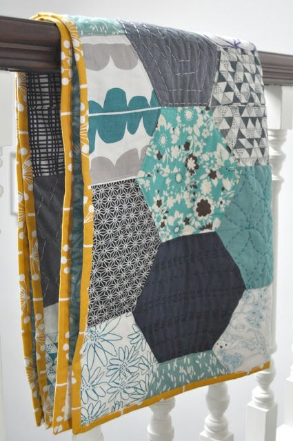 Honeycomb quilt - love the fabrics and contrast binding