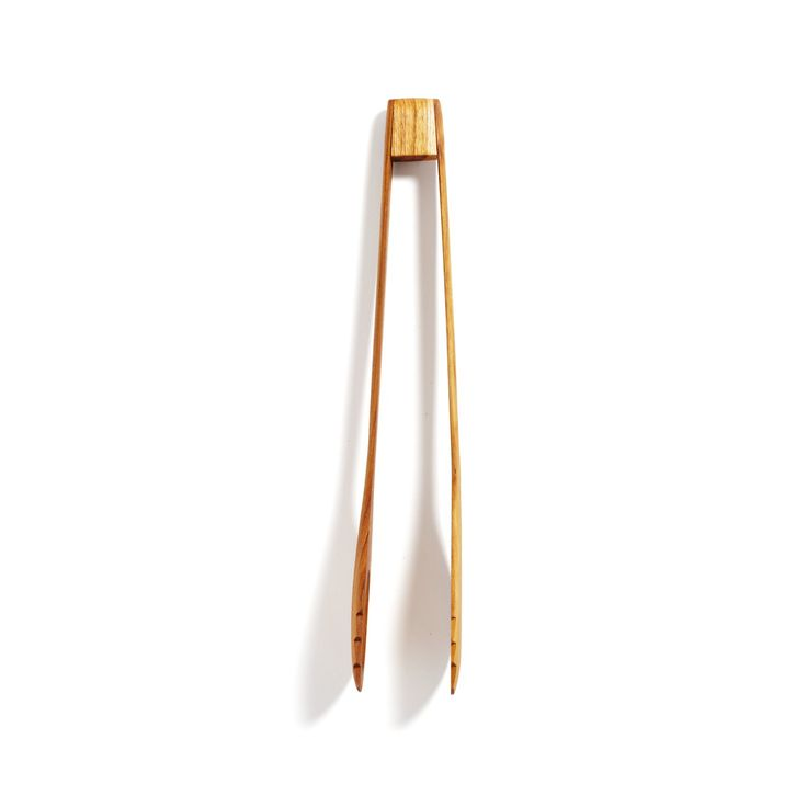 Hewn from excess material the logging industry leaves behind, these teak tongs evoke the lushness of their tropical origin. Sustainable and functional, the tongs add a touch of custom woodwork to the kitchen.
