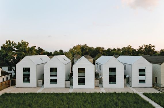"The series of pitched white buildings was inspired by the work of architect Hugh Newell Jacobsen. ""The shell of the house is a very simple form,"" says Matthew Ford, ""no turns or intersecting roof sections. This allowed me to use solid but inexpensive framing and roofing crews. We are always looking for the point where simplicity and luxury meet."" Photo by: Jack Thompson"