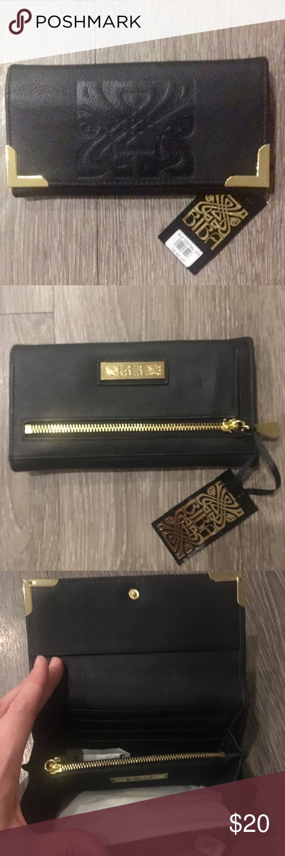 BiBA NWT black leather wallet w gold hardware BiBA black wallet, new with tags from House of Fraser in London.  Given to me by my ex mother-in-law who is reminiscent of an evil Mary Berry so just in case it curses you I will take whatever you are offering as long as it is reasonable. BiBA Bags Wallets