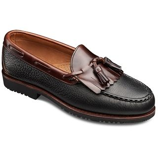 Allen Edmonds - Nashua Black/Brown $195. Allen Edmonds 'Nashua' loafers are as easy to wear as your favorite bedroom slippers, but daily wear ready. Traditional moccasin-style design is hand sewn for lasting beauty and reassuring durability. A single shawl, side lacing, and tassels add handsome accents to this classic style. And the outsole is a sturdy Vibram Stalker sole for ample traction and longevity.