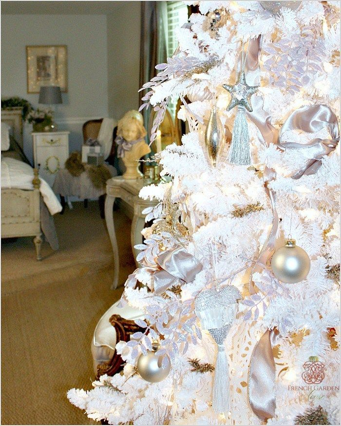An elegant Christmas tree ~ with sweet statue in the background