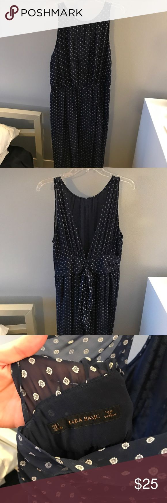 Zara jumpsuit Blue patterned Zara jumpsuit. Open back with tie detail. The fabric is mostly sheer. Wide, flowy legs. Fits small - I typically wear a small or medium in Zara and this is a large. Zara Pants Jumpsuits & Rompers