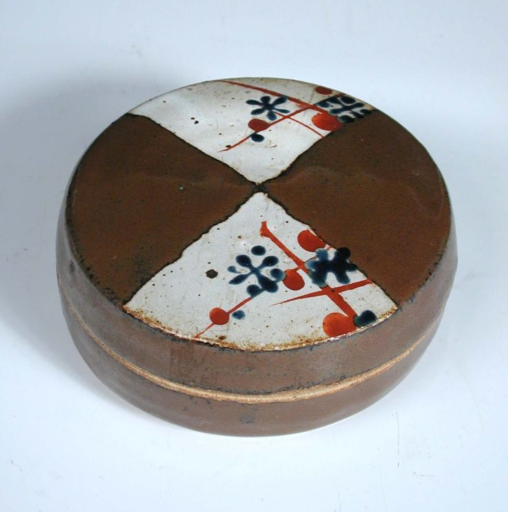 John Maltby (born 1936), a stoneware circular box and cover, the cover painted with resist panels