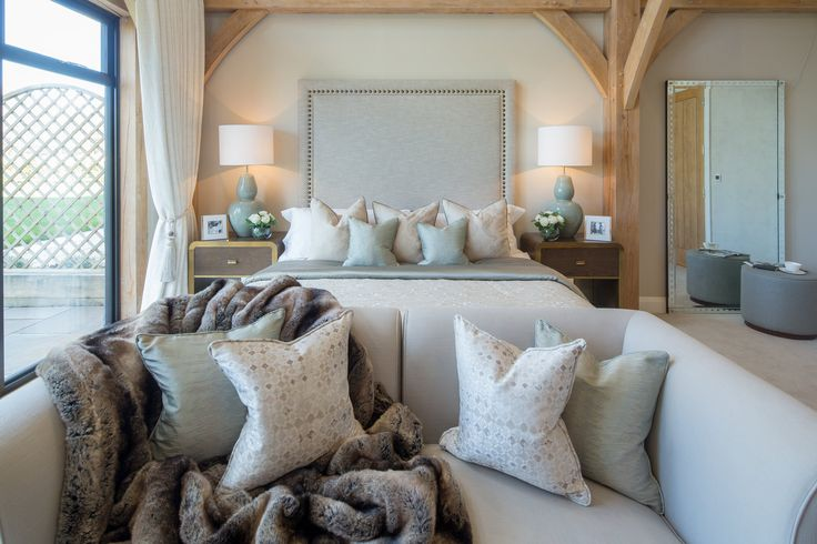 At the foot of the master bed elegantly sits this bespoke made seating, dressed beautifully with Camengo and Zoffany cushions and a luxurious fur throw.