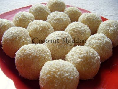 Coconut Sweeta (Laddu)  Condensed milk– 1 tin  Grated coconut – 250gm    Keep aside about 50 gms of coconut aside. In a thick bottomed wok,add the rest of the coconut and the milk, mix well. Cook on low flame for about 5 minutes.When the mixture starts leaving the sides of the wok,switch off the flame and transfer the mix to another bowl and let it cool.  Grease your palms with butter and make small balls.Roll them in coconut and arrange them on a butter paper.