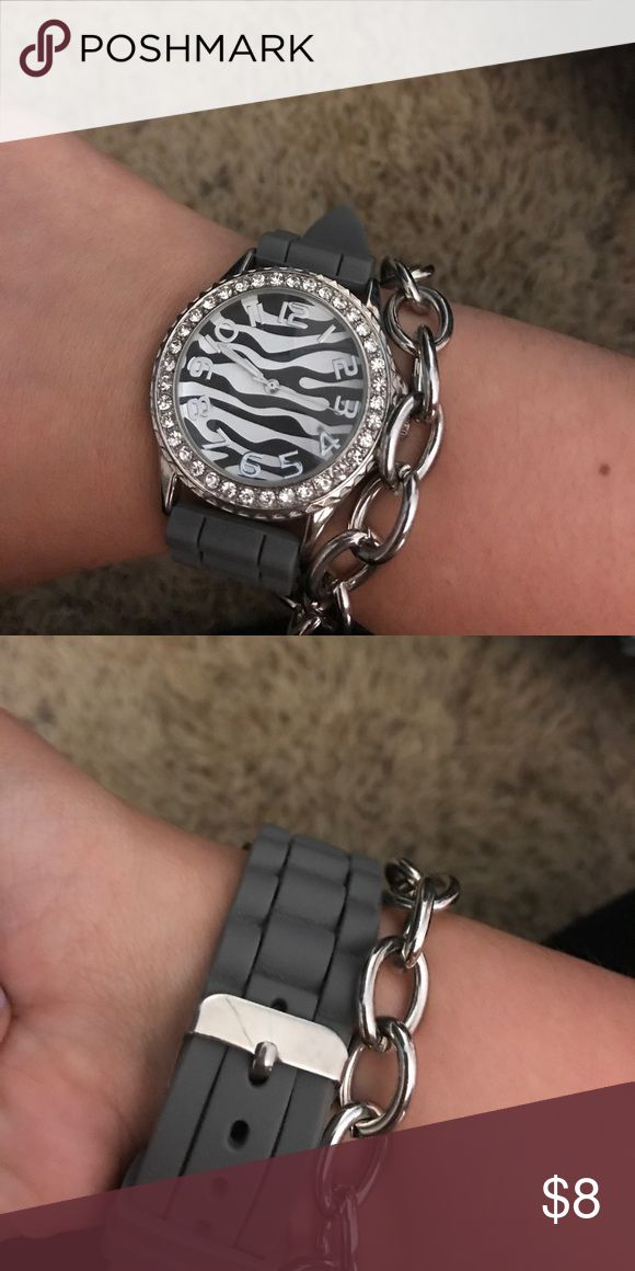 Rubber watch with zebra and rhinestones A gray rubber watch with a zebra face and rhinestones around it (bracelet does not come with it) Accessories Watches