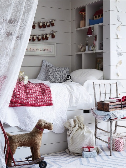 If you had a small narrow room, length allowing, you could do two single beds, head to head, with open shelving between, and a curtain for each bed for privacy.  Wouldn't that feel like the berth on a train?