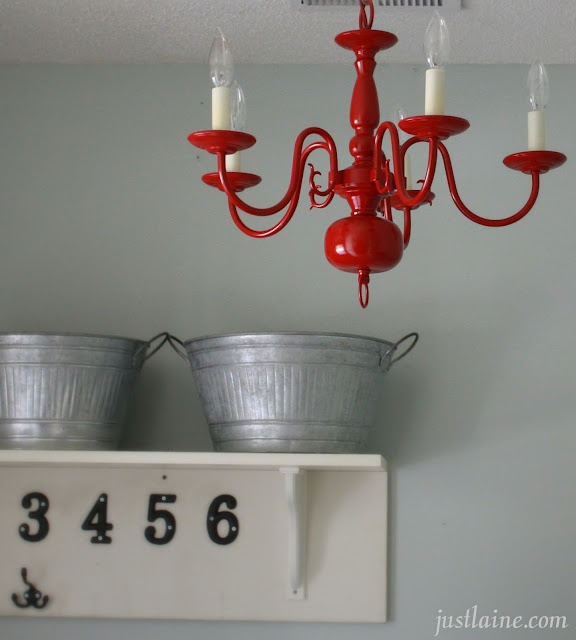 Neat way to redo an ugly old chandelier. Would be so cute in my woodshop.