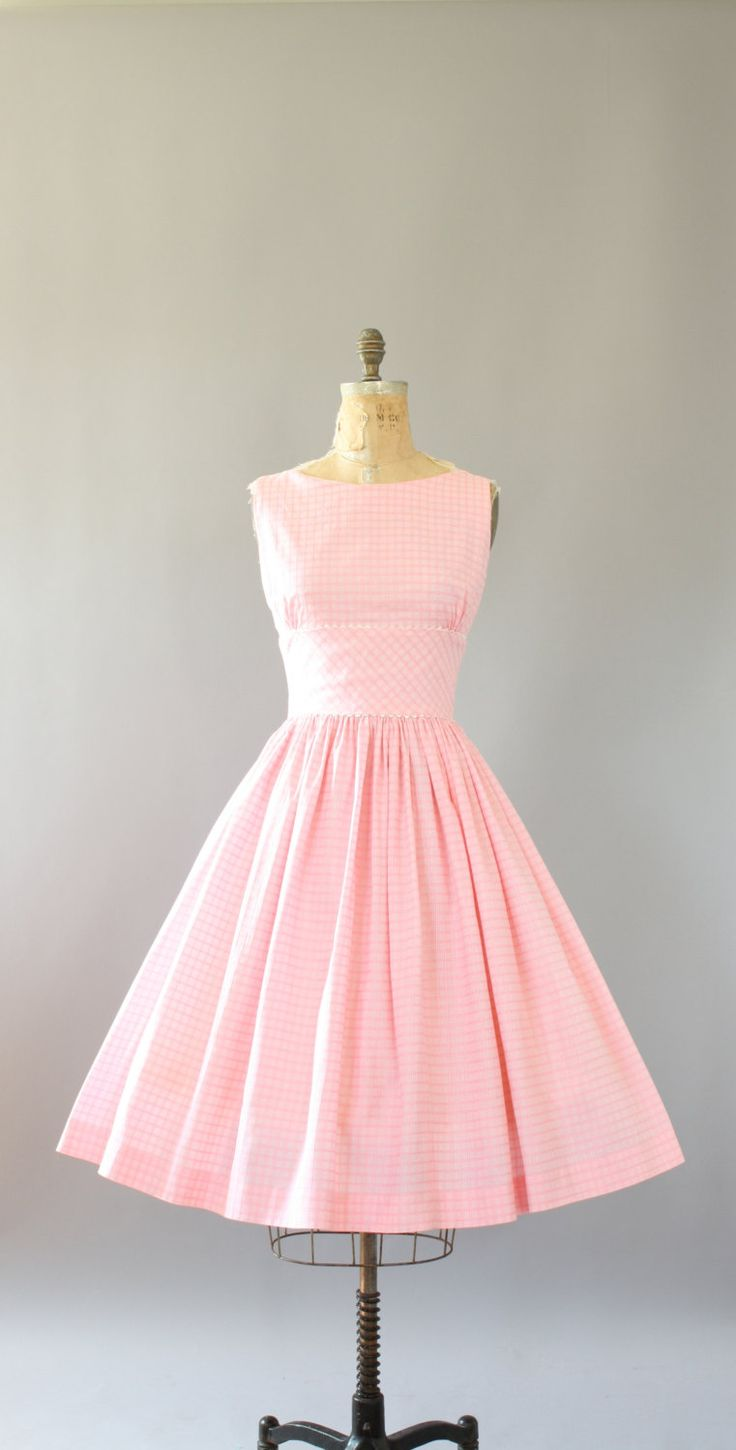 Vintage 50s light pink checkered cotton dress with amazing low back. Shelf bust with Ric-Rac. Buttons up in back. Full skirt. Crinoline worn