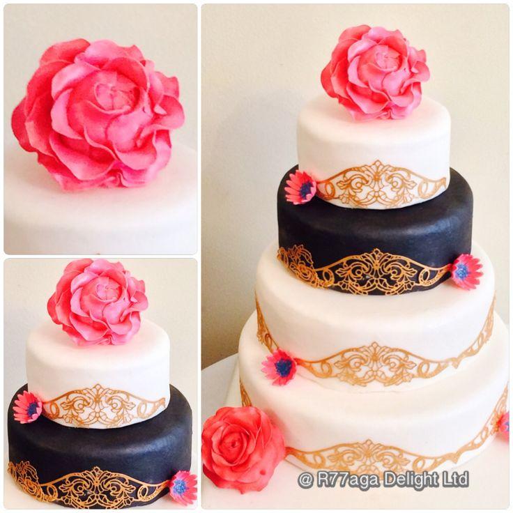 Pink, black & white wedding cake of vanilla sponge filled with lemon buttercream & fruit cake http://www.facebook.com/R77aga