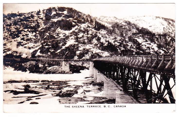 A photo postcard, which shows a view of the Skeena Bridge, which crosses the Skeena River between Terrace and Thornhill. It opened in 1925 and is 300m in length, with approach ramps 50m.