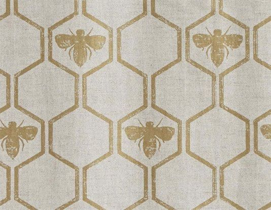 Honey Bees Fabric A neutral linen union with a a honeycombe and bee design in gold.
