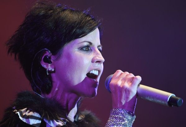 Dolores O'Riordan Photos - Irish singer Dolores O'Riordan of Irish band The Cranberries performs on stage during the 23th edition of the Cognac Blues Passion festival in Cognac on July 07, 2016. / AFP / GUILLAUME SOUVANT - Dolores O'Riordan Photos - 17 of 37