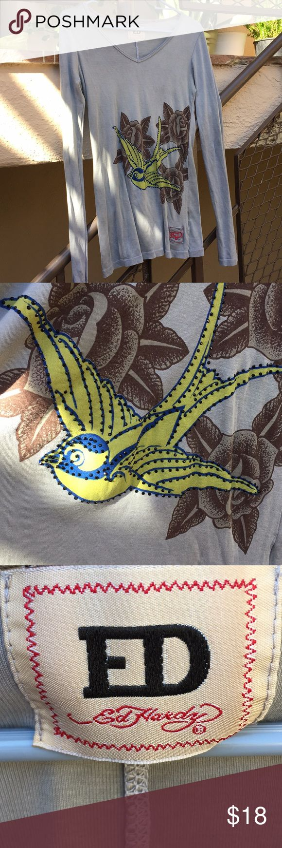 """Ed Hardy Women's Green Top W/Beaded Yellow Bird This is so cool! The yellow black beaded bird and brown roses are beautiful. The top is v neck pullover and in great condition! It is a large and fabric is stretchy so it will be form fitting. It measures 17"""" across pit to pit and in 27"""" shoulder to hem. Long slim sleeves that are 26"""" long. This will be your favorite top with those skinning jeans! Ed Hardy Tops Tees - Long Sleeve"""