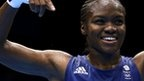 Great Britain's Nicola Adams made history by beating China's Ren Cancan to become the first woman to win an Olympic boxing gold medal.