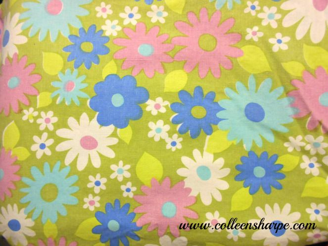flower power vintage cotton floral sheet with green background and blue light blue and pink