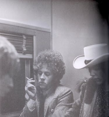 Chris Hillman smoking a cigarette with Gram Parsons to the right, 1969