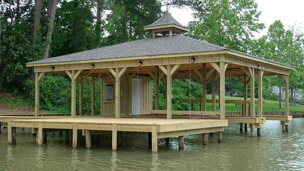 Lake docks design high tide docks introduction lake for Boat house plans pictures