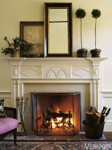 antique mantels in gil schafer's work-- from Frances Purcell